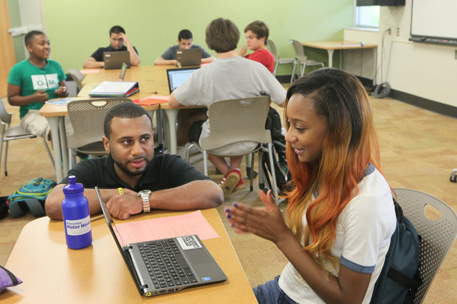 Nasif Rogers MBA '14 works with student Lydia Hawthorne (Michael Sears/Milwaukee Journal Sentinel)